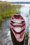 Summer's lake scenery with wooden boat Royalty Free Stock Photos