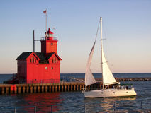 Michigan red lighthouse with sailboat  Stock Photography