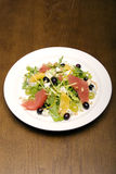 Summer salad. Salad made of citrus, grape and cheese stock image