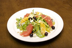 Summer salad. Salad made of citrus, grape and cheese stock images