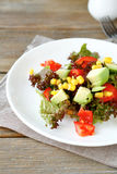Summer salad with avocado, tomatoes and corn on a white plate Royalty Free Stock Image