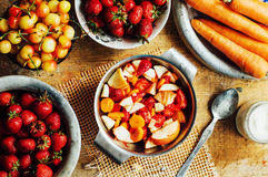Summer salad with fresh home-natural fruits and vegetables. Prep Stock Photography