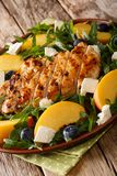 Summer salad of grilled chicken, peaches, blueberries of arugula Royalty Free Stock Photography