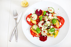 Summer salad of mango, tomato, beetroot, cucumber and feta Stock Image