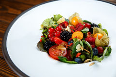 Summer salad with nut mass and seasonal berries selected focus. Summer salad with nut mass and seasonal berries, selected focus stock photography