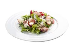 Summer salad with peach, bacon and arugula. royalty free stock photography