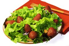 Summer Salad with Strawberries. Fresh summer salad with watercress lettuce, greens, mint, strawberries and almonds Royalty Free Stock Photography