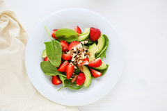 Summer salad with strawberries on plate Stock Images