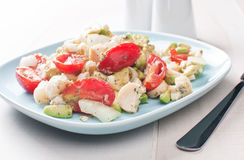 Summer salad with tomatoes, avocado and hearts of palm Royalty Free Stock Photography