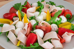Summer salad with turkey breast, greens, tomato and mozzarella. Top view. Close-up Stock Photo