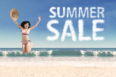 Summer sale clouds and jumping woman Stock Photography