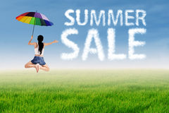 Summer sale clouds with a woman Stock Images