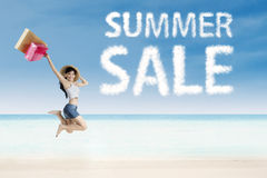 Summer sale clouds and woman Royalty Free Stock Images