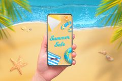 Summer sale on mobile phone display. Modern phone with round edges in woman hand Stock Image