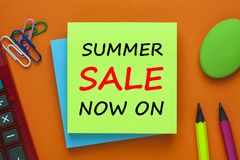 Summer Sale Now On Concept. SUMMER SALE NOW ON written on green note on a orange background  with pencil and calculator a side . Business Concept. Top view Stock Photos
