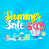 Summer Sale 50 Off Lettering over Blue Blurred Background Royalty Free Stock Image