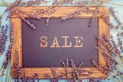 Summer sale and shopping concept. Summer sale or shopping concept with lavender flowers and blackboard royalty free stock image