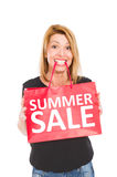 Summer Sale. Shopping woman holding a gift bag with Summer sale text Royalty Free Stock Photography