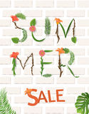 Summer sale, summertime lettering. Tropical palm leaves and flowers background Royalty Free Stock Image