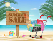 Summer sale wood board and shopping cart with beach background Stock Photography