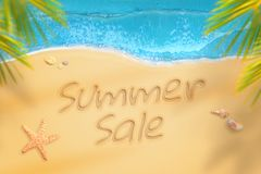 Summer sale written on beach. Summer time travel and relax Royalty Free Stock Photography