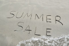 Summer sale written in the sand Royalty Free Stock Photo