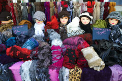 Summer Sales of Hats, shawls and gloves. Colourful shop in France with hats, shawls and gloves, summer sales stock photography