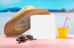 Summer sales or offer banner template. White square paper on towel with sunglasses, yellow cocktail and fun hat. royalty free stock image