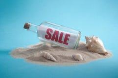 Summer sales message bottle stock images
