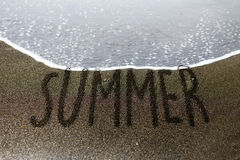 Summer sand writing stock photo