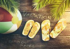 Summer sandals with beach ball on wood Stock Photo