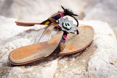 Summer sandals on a sandy beach Stock Photography