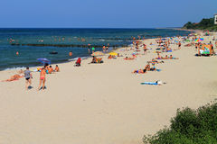 In the summer on the sandy coast of the Baltic Sea in the city of Zelenogradsk Royalty Free Stock Images