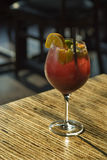 Summer Sangria. A cool glass of Sangria on a table. Red wine, fruit, brandy, soda Stock Photo