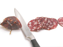 Summer sausage and  kitchen knife Royalty Free Stock Images
