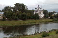 Russian Orthodox church across the river on an overcast day. Summer scene from around Vologda, Russia royalty free stock photo
