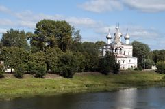 Russian orthodox church across the river on a sunny day. Summer scene from around Vologda, Russia stock photos
