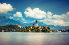Summer scene in the park of Bled lake with medieval castle Blejski grad. Summer scene in the park of Bled lake with medieval castle Blejski grad, Slovenia Stock Photos