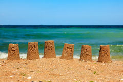 Summer script on sand towers Royalty Free Stock Photos
