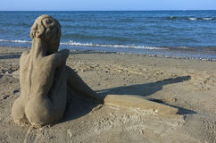 Summer: sculpture of sand on the beach Royalty Free Stock Photo