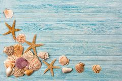 Summer sea background - shells, star on a wooden blue background stock photo