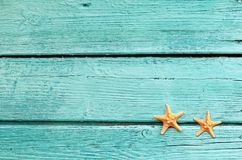 Summer sea background - starfish on blue wooden background Royalty Free Stock Photography
