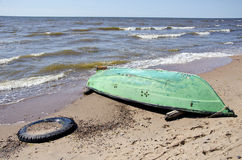 Summer sea beach with green boat Royalty Free Stock Photo