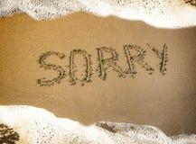 Summer sea beach, the inscription on the sand-sorry. Summer sea beach, the inscription on the sand-sorry stock photography