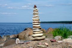 Summer sea coast. Seashore, seacoast, stones, sunshine, sky, relax, lounge, estonia, bay Stock Image