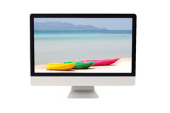 Summer sea with colorful kayak on computer monitor Royalty Free Stock Image