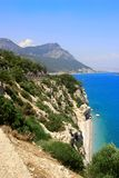 Summer sea landscape. Mediterranean beach and mountain Royalty Free Stock Photo