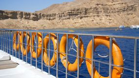 Summer, sea, orange lifebuoy, hanging aboard a ferry, ship. special rescue equipment of the ship. saves the life of a stock video