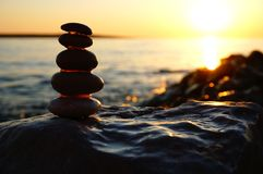 Free Summer Sea Sunset Background With Pebble Beach And Stacking Stones Silhouette In Front Of The Sun Stock Photography - 156846512