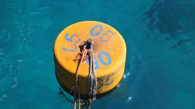 Summer, sea, in transparent bluish water floats orange buoy stock footage